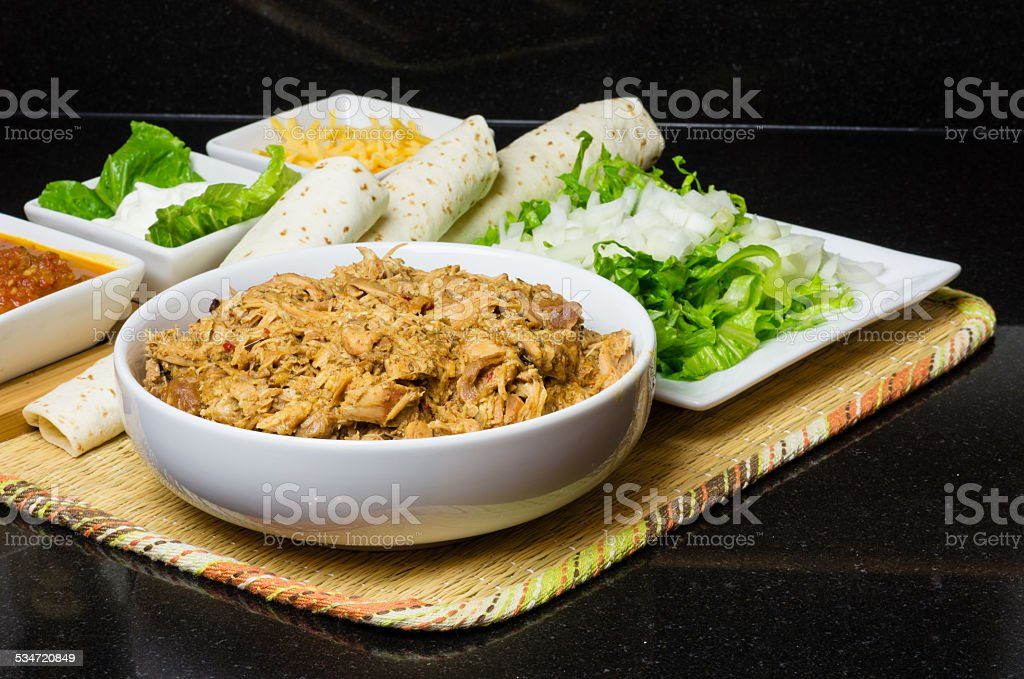 Pulled chicken and ingredients for tacos stock photo
