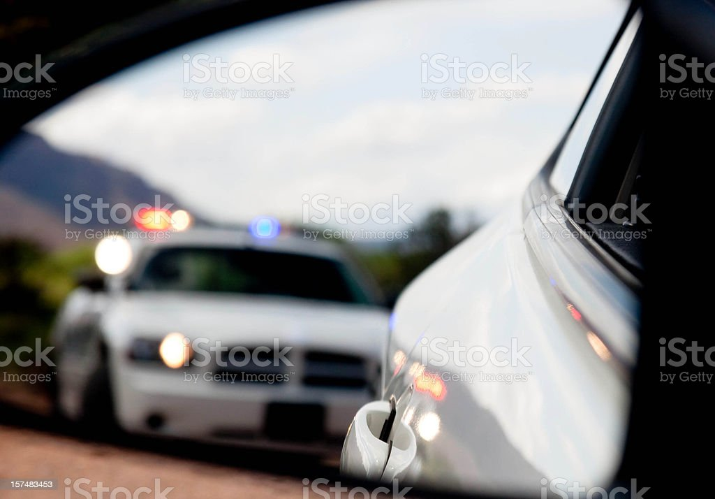 Pulled over by the Police in blurred Dodge Charger stock photo