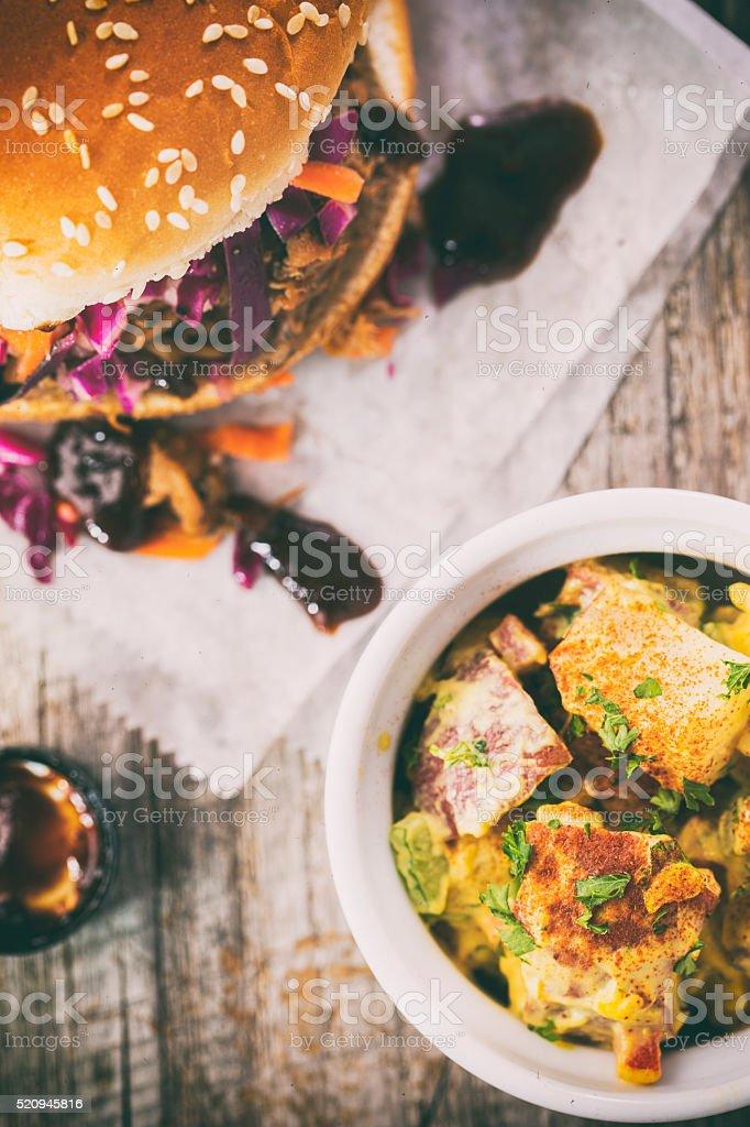 Pulled Pork Sandwich and Potato Salad stock photo