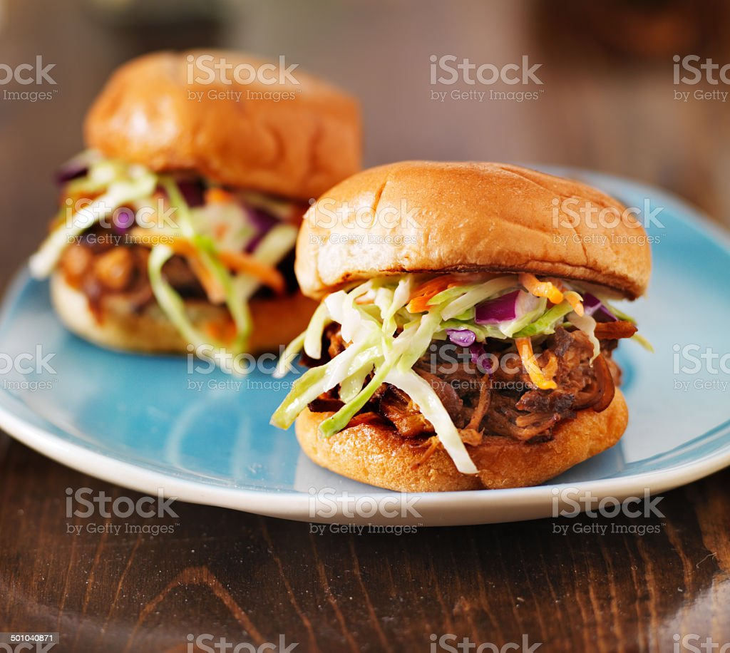 pulled pork with bbq sauce on a blue plate stock photo