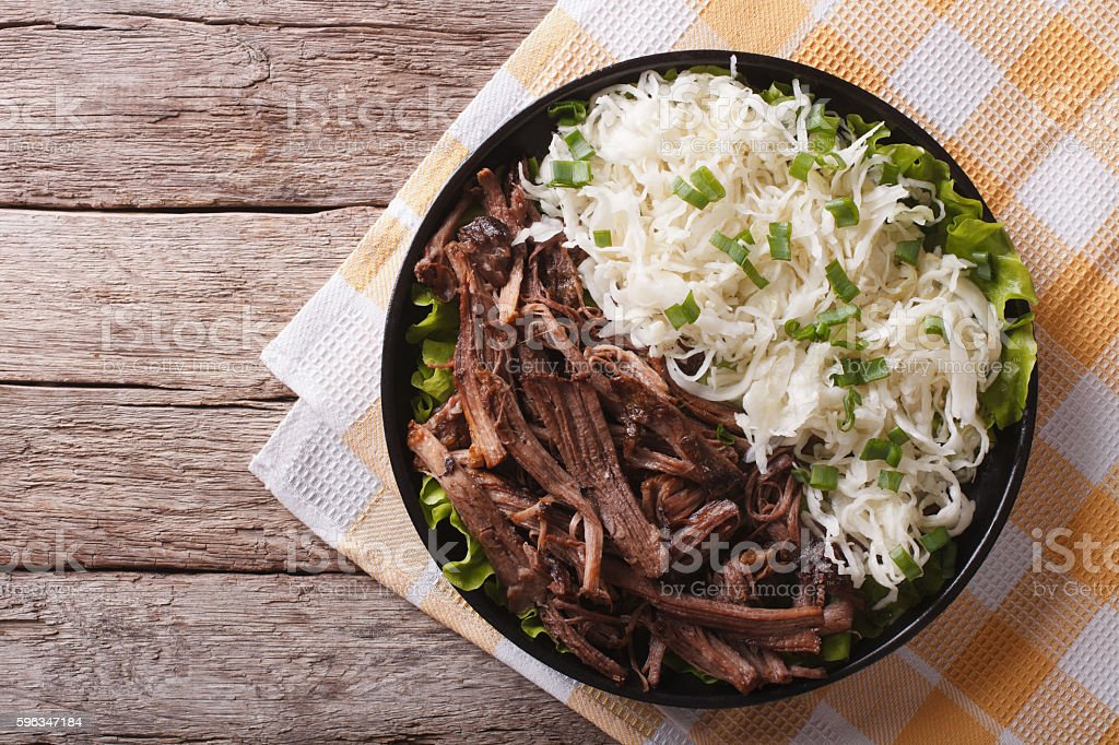 Pulled pork with coleslaw on the table. horizontal top view stock photo