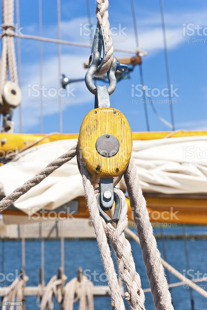 Pulley and ropes on a sailboat royalty-free stock photo