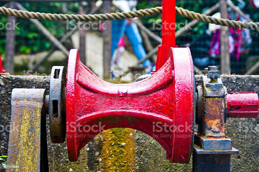pulley red metal with rust stock photo