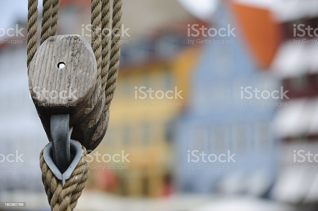 Pulley, ropes against blurred houses royalty-free stock photo