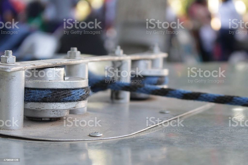 Pulley with rope on table royalty-free stock photo
