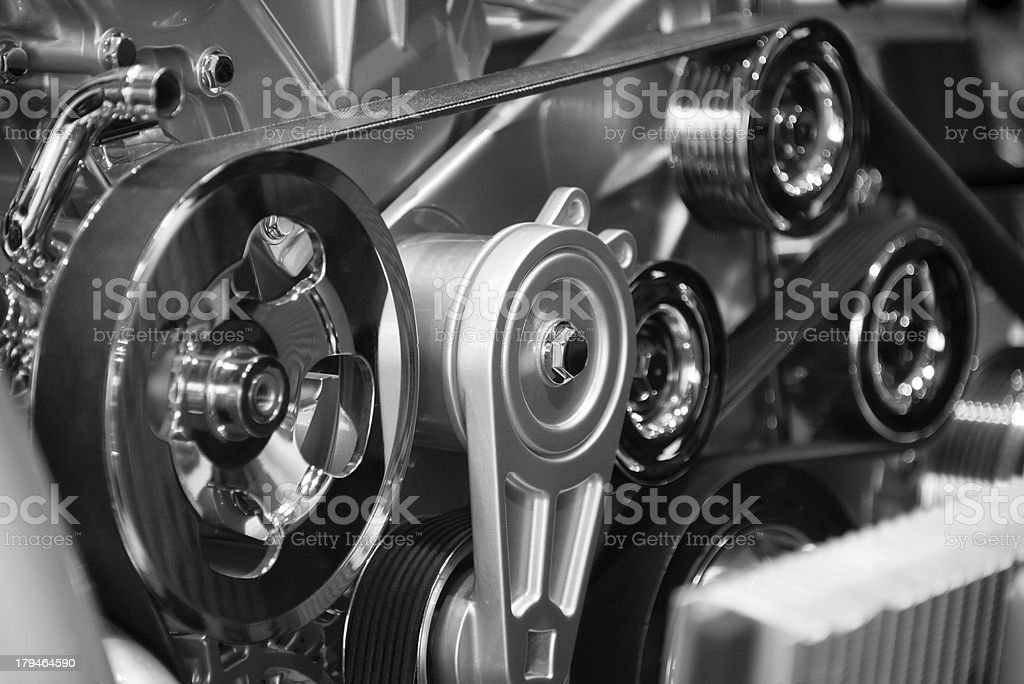 Pulleys and belts of a car engine inside mechanism stock photo