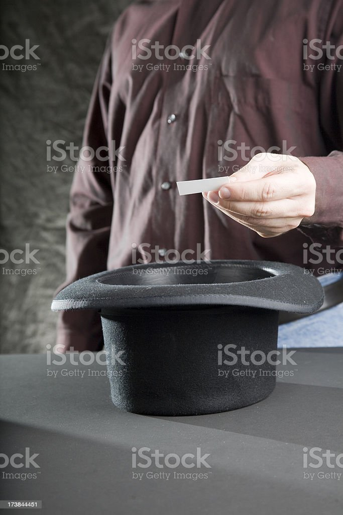 Pulling A Name From The Hat royalty-free stock photo