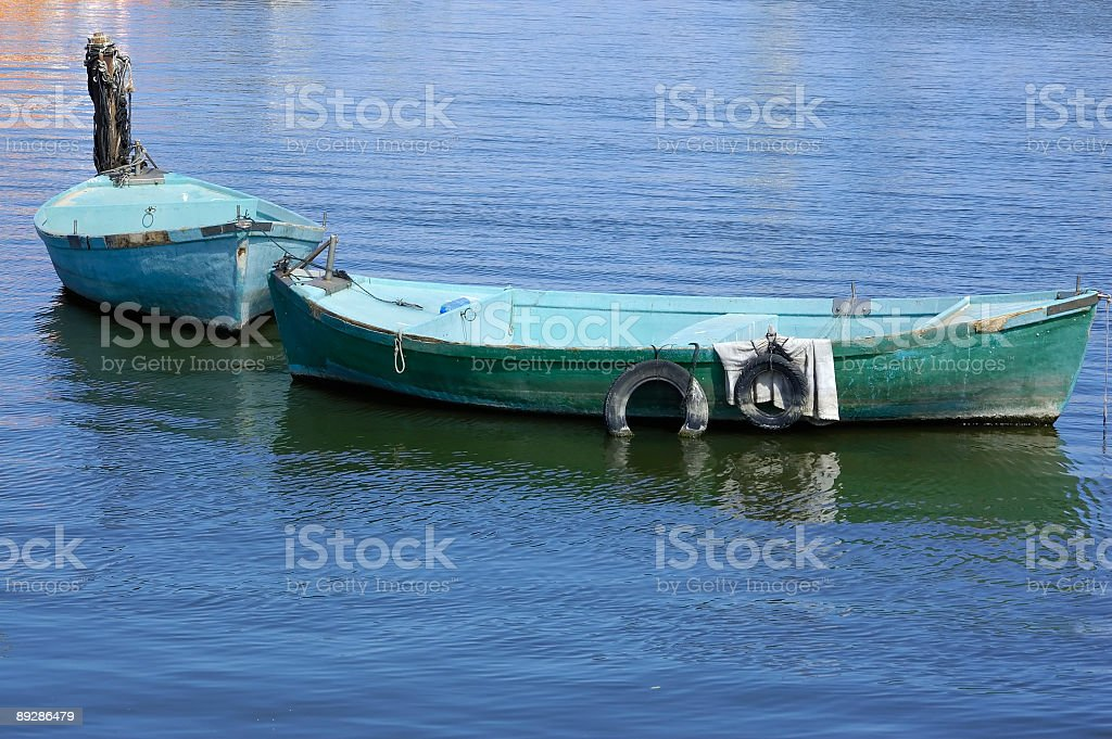 pulling boat on a leash royalty-free stock photo