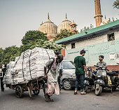 Pulling cart in Old Delhi India