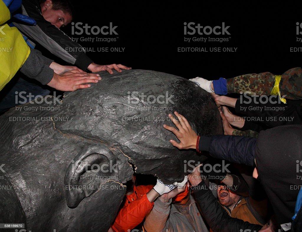 Pulling down of Lenin monument stock photo