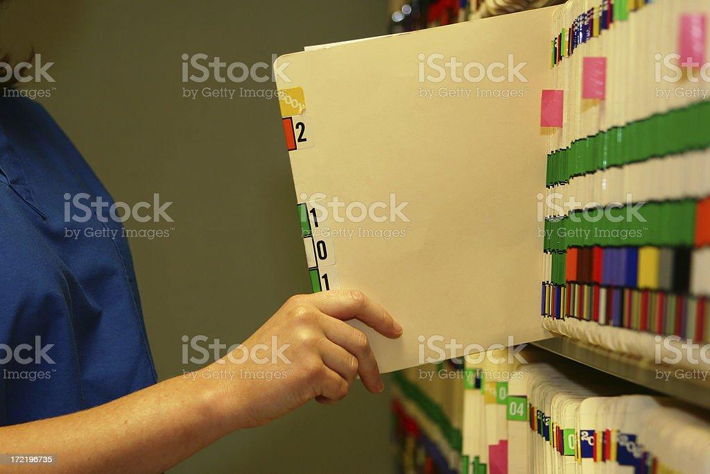 Pulling Medical Chart royalty-free stock photo