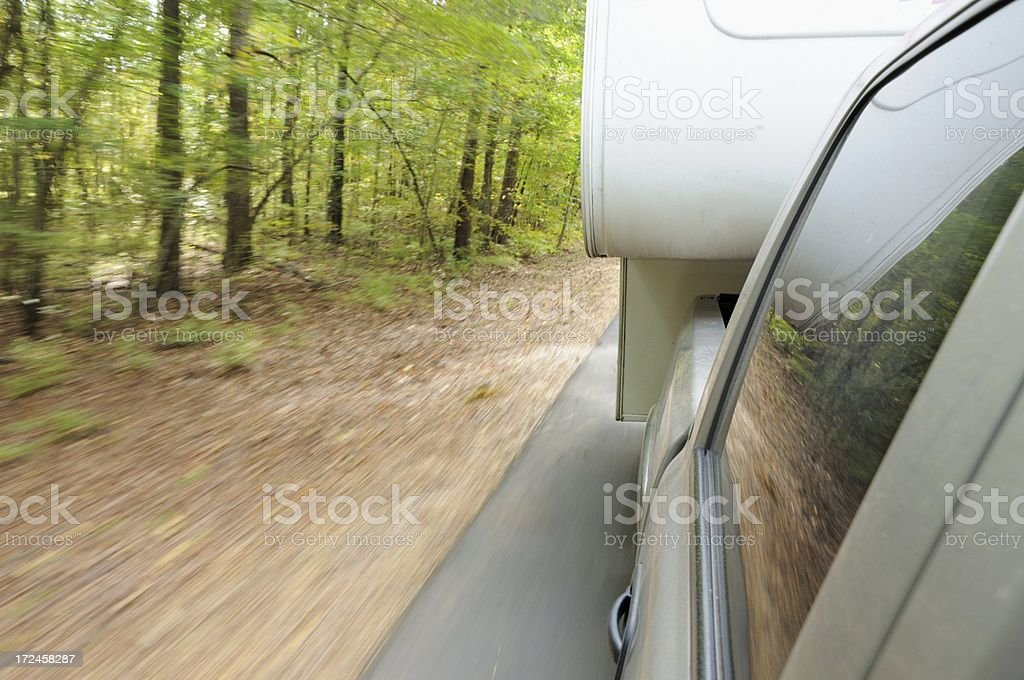 Pulling rv fifth wheel travel trailer down road royalty-free stock photo