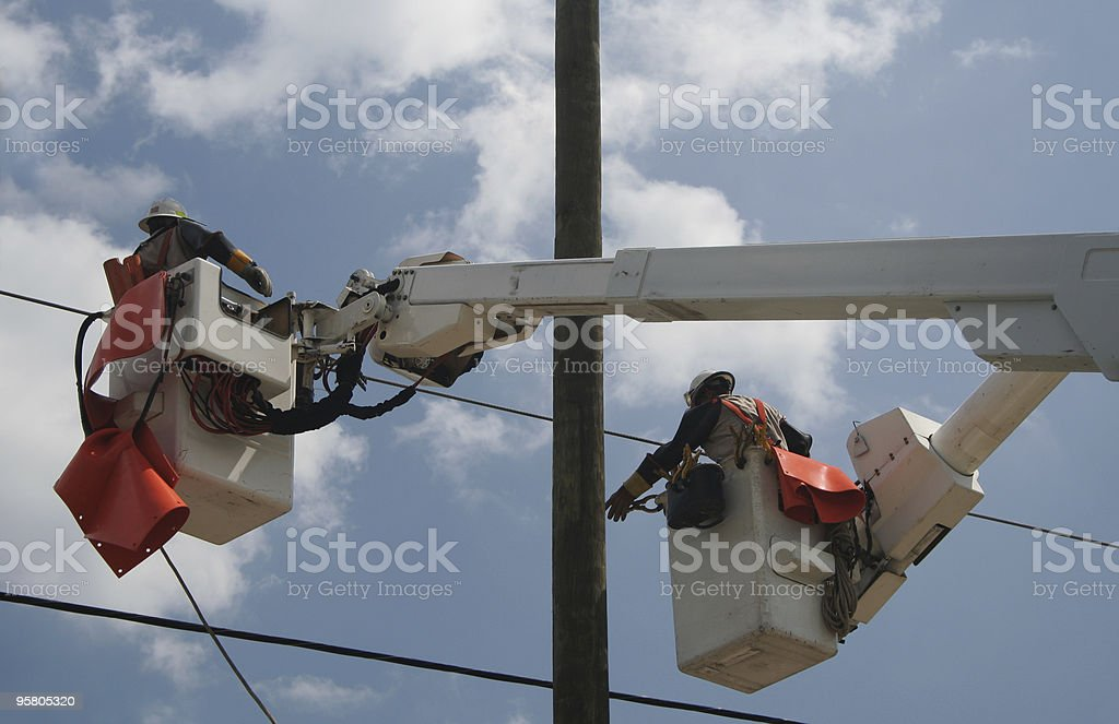 Pulling the Power Lines royalty-free stock photo