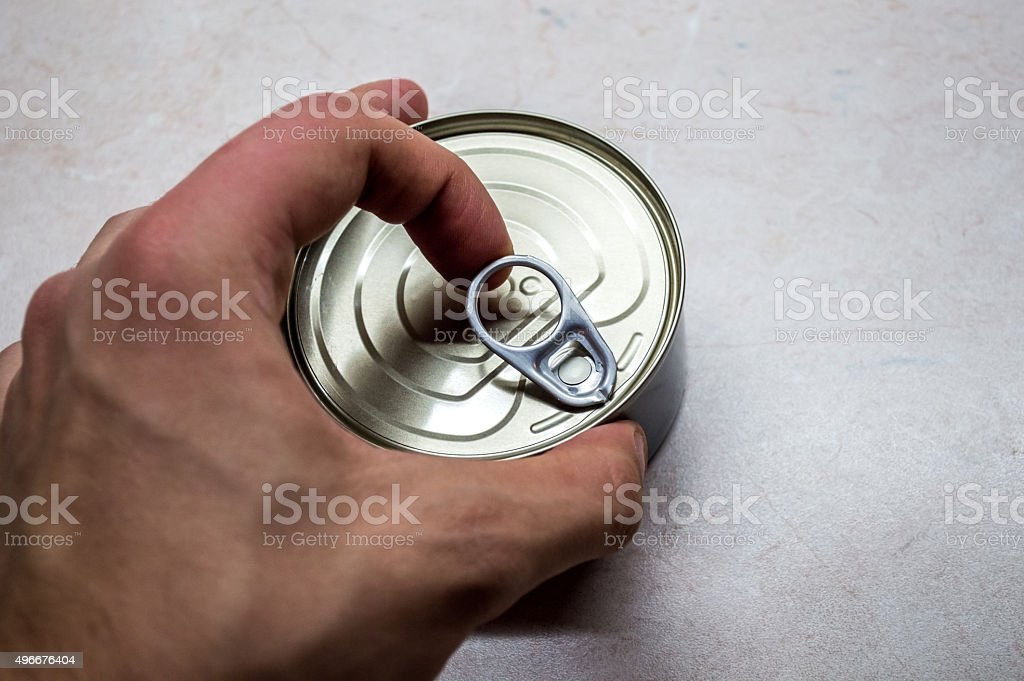 Pulling the Ring Pull on a Metal/Tin Can royalty-free stock photo