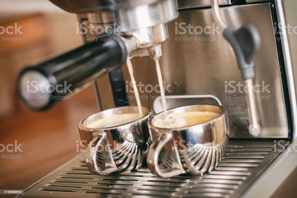 Pulling Two Shots with an Espresso Machine stock photo