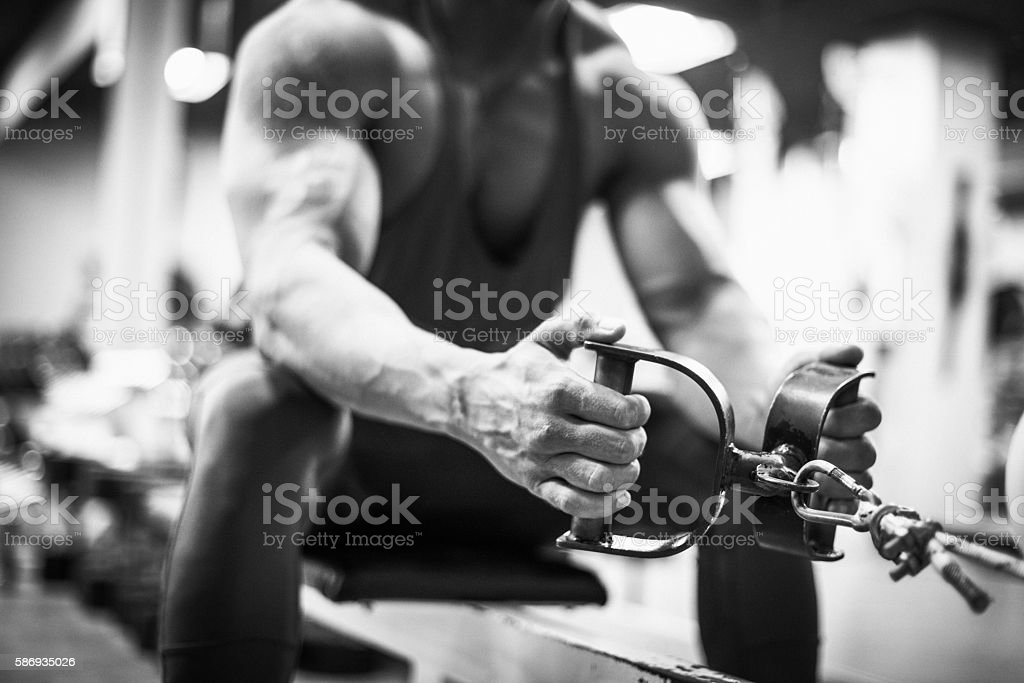 Pulling weights for back muscles stock photo
