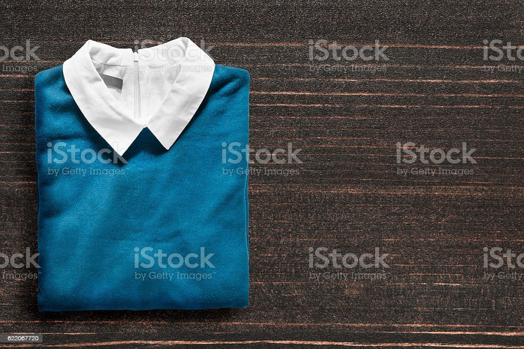 Pullover on wooden background stock photo