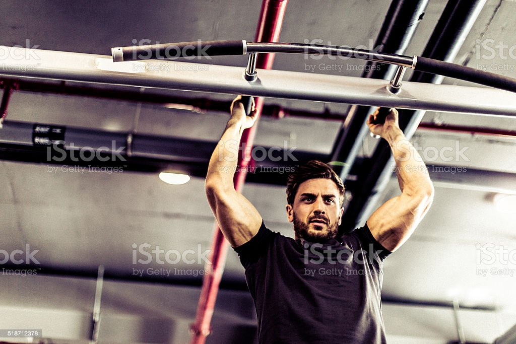 Pull-Ups at the Gym stock photo