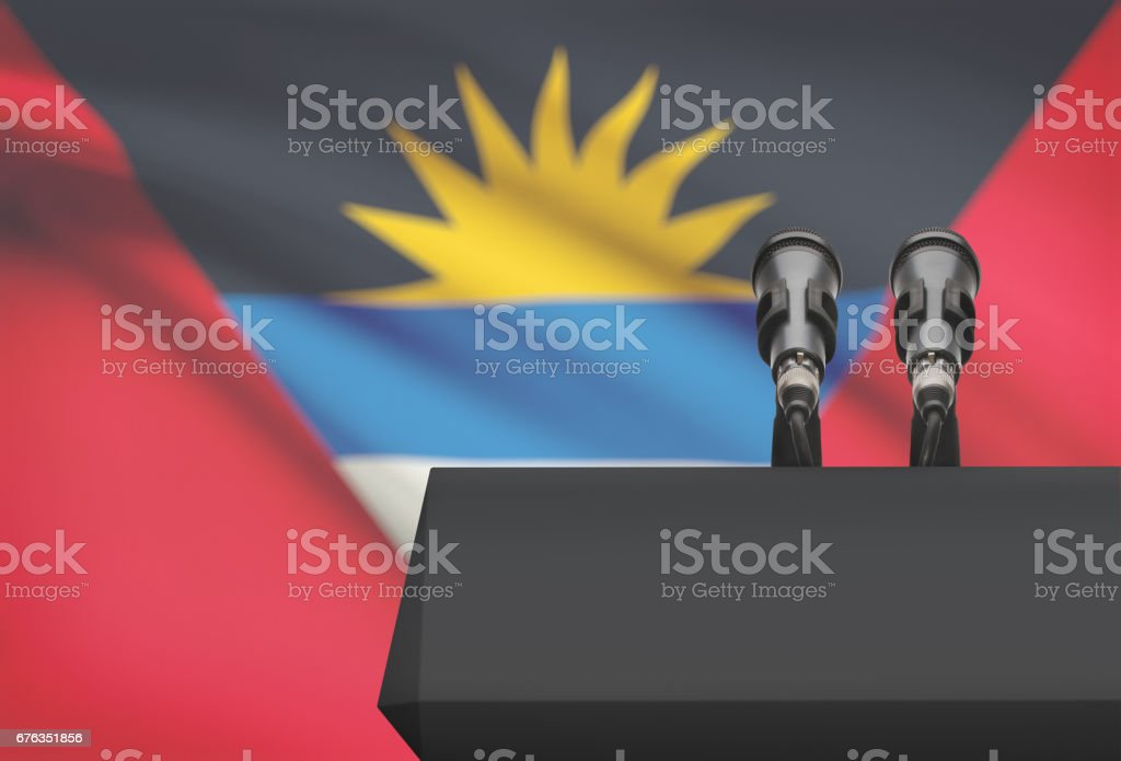 Pulpit and two microphones with a national flag on background - Antigua and Barbuda stock photo