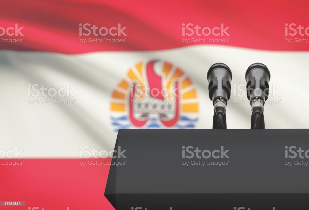 Pulpit and two microphones with a national flag on background - French Polynesia stock photo