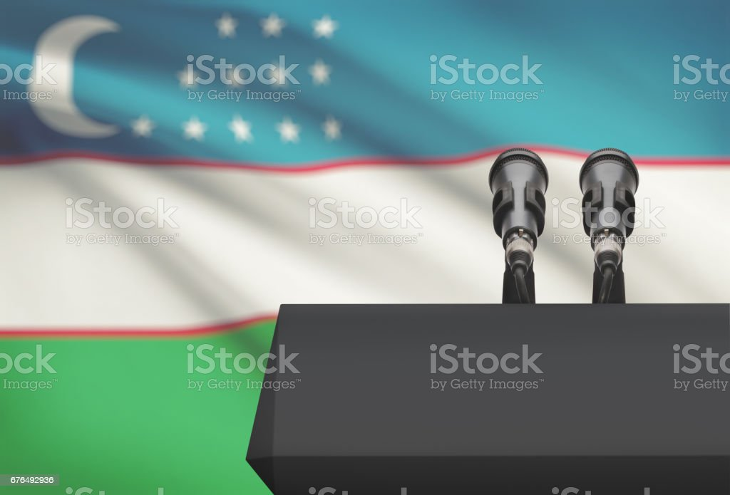 Pulpit and two microphones with a national flag on background - Uzbekistan stock photo