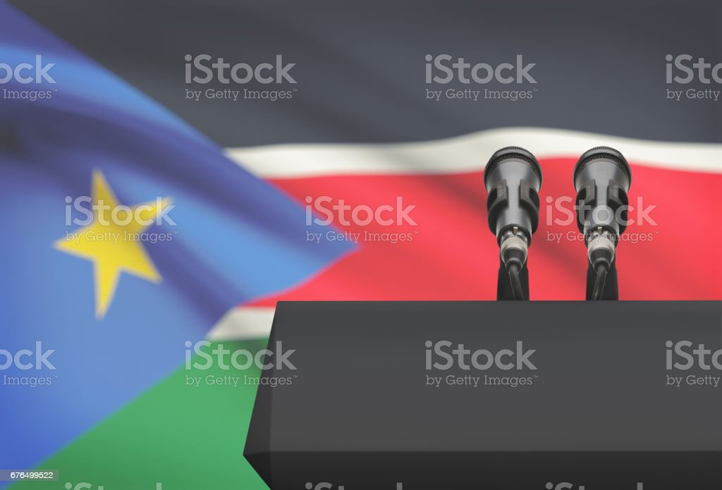 Pulpit and two microphones with a national flag on background - South Sudan stock photo