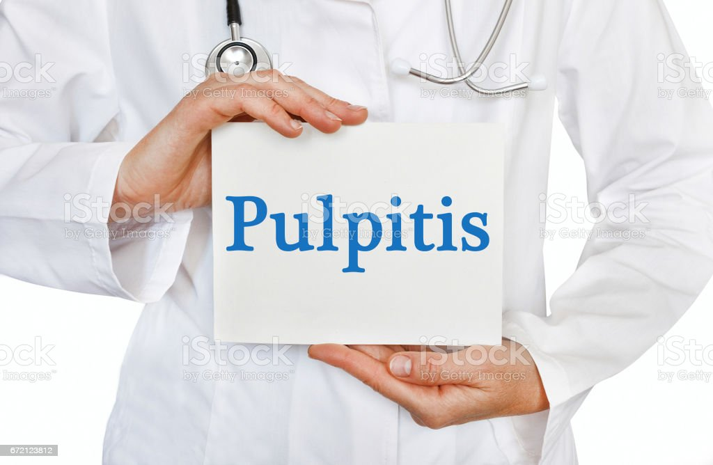Pulpitis card in hands of Medical Doctor stock photo