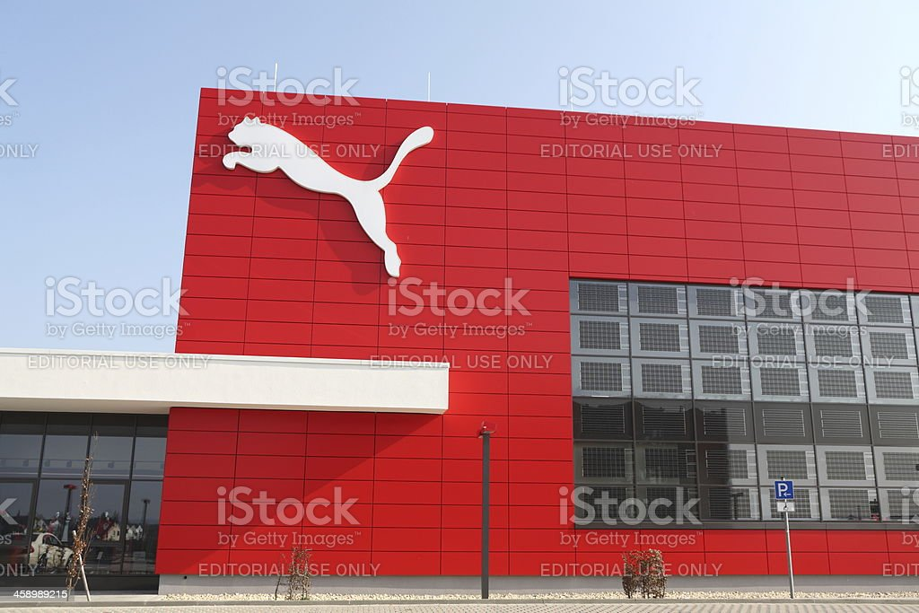 Puma logo on red wall stock photo