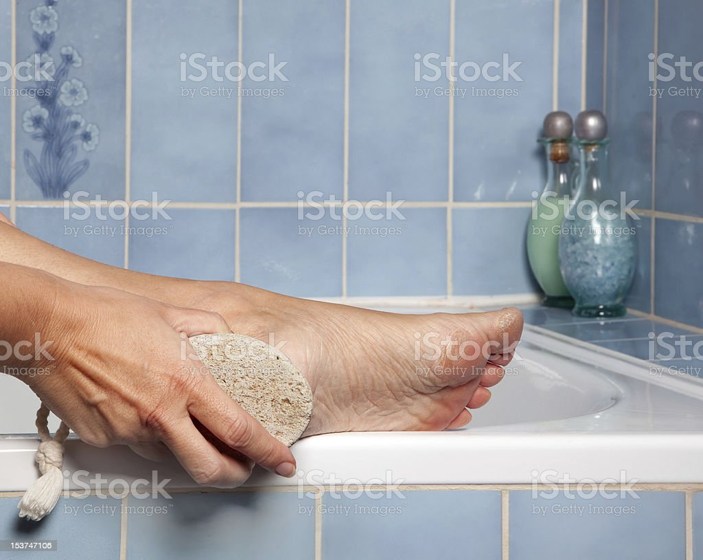 Pumice stone removing callus royalty-free stock photo
