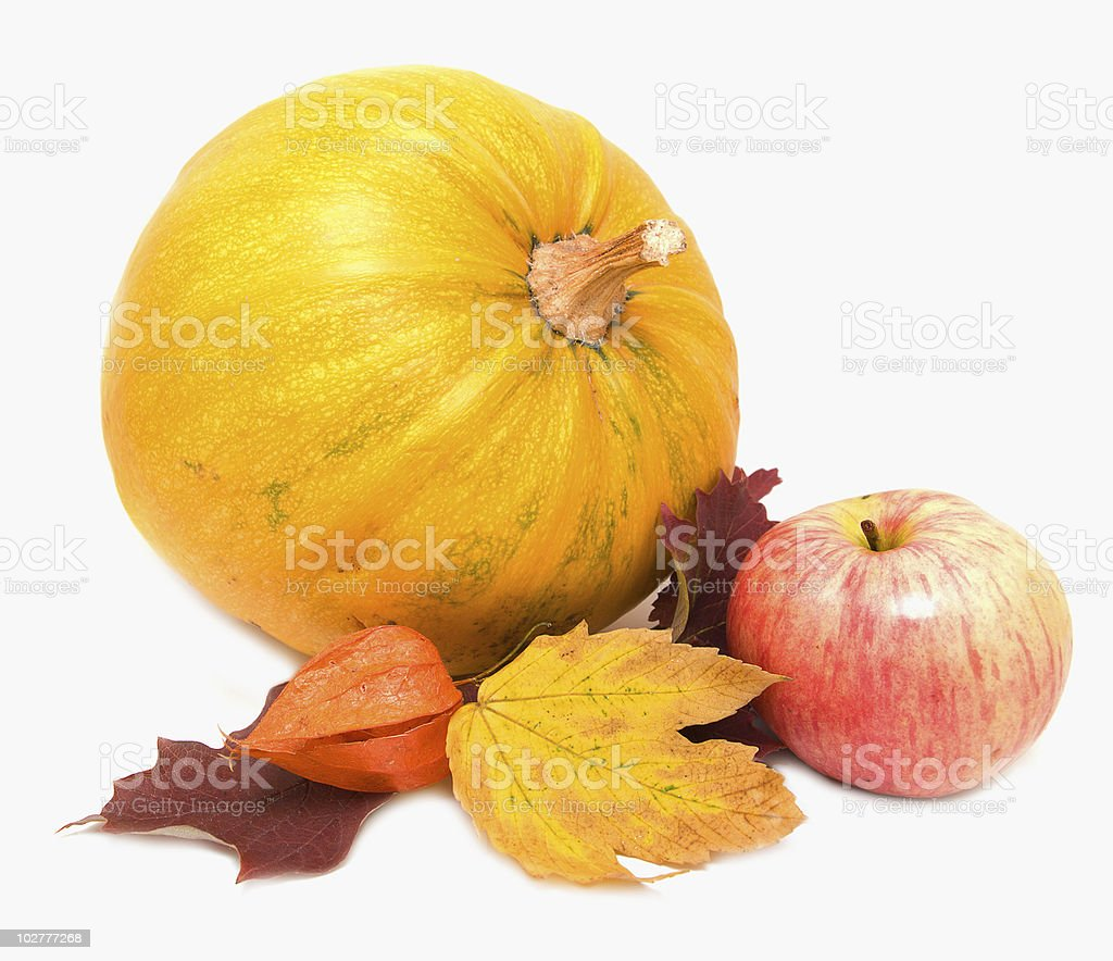 Pumkin, fall leaves and apple stock photo