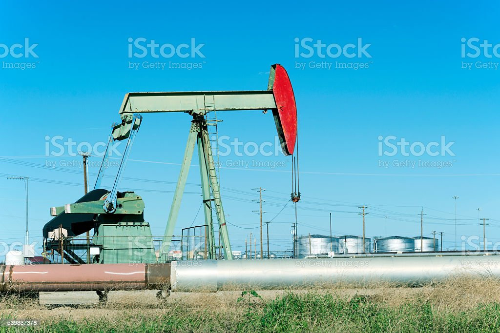 Pump and pipes in oil field stock photo