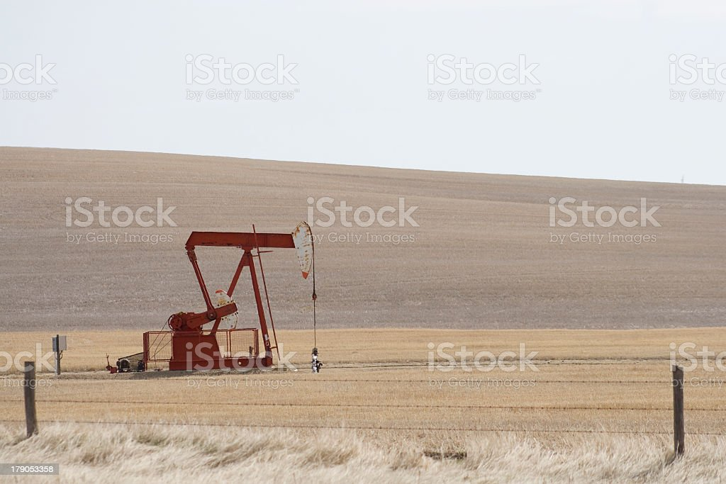 pump jack in field royalty-free stock photo