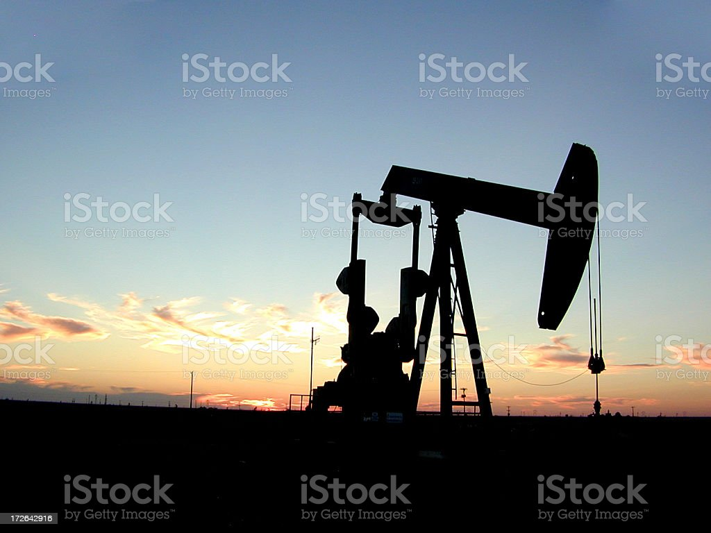 Pump Jack in Texas at Sunset stock photo