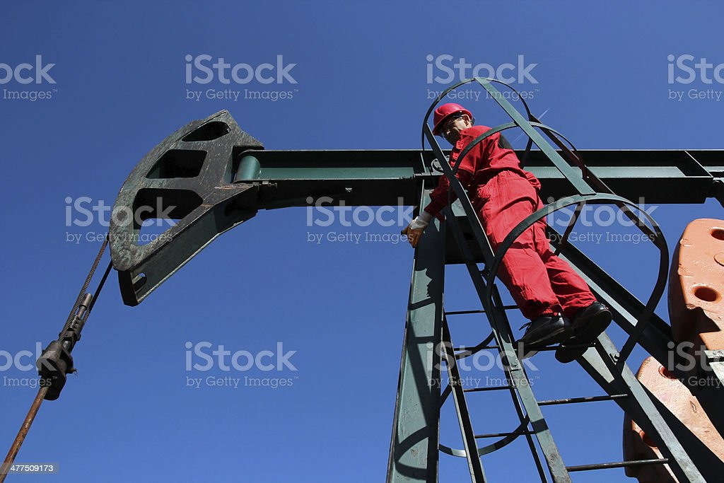 Pump Jack Service Technician royalty-free stock photo