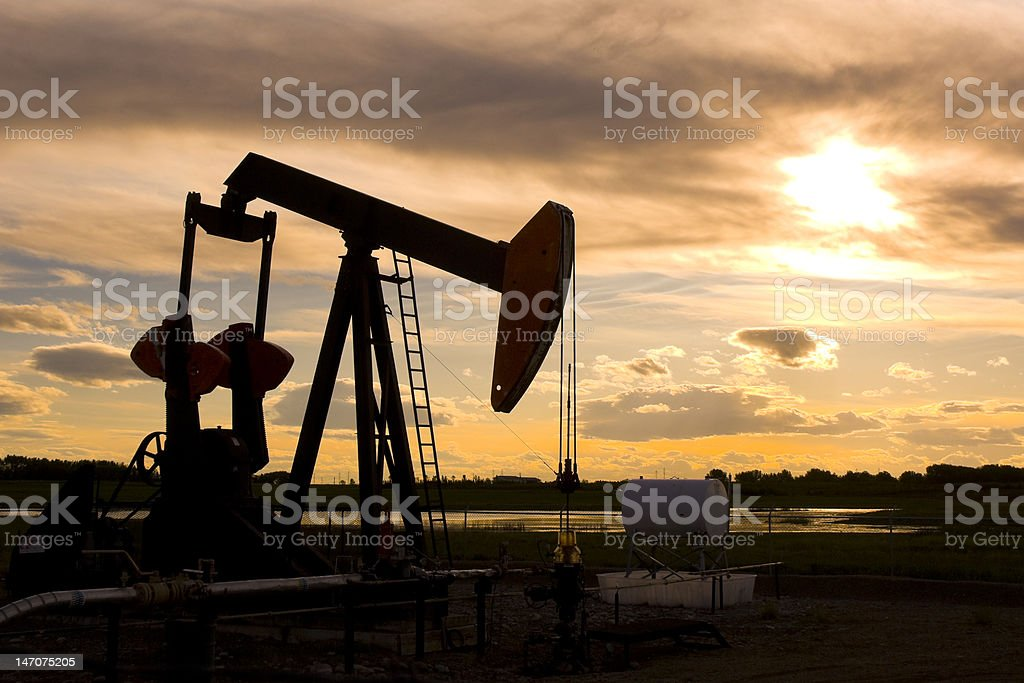 Pump Jack Silhouette at Sunset royalty-free stock photo