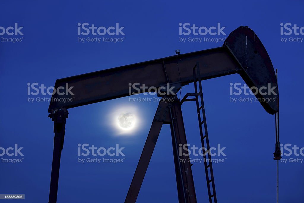Pump Jack Sillhouette and Full Moon royalty-free stock photo