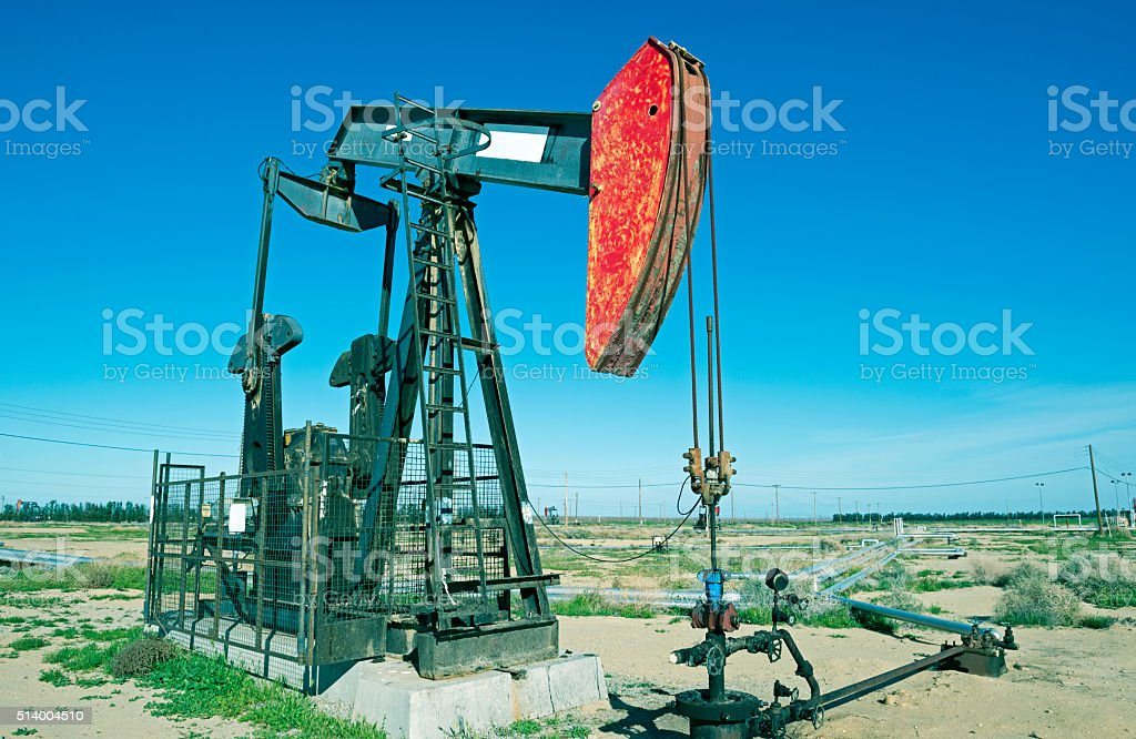 Pump jacks and oil field in central California stock photo