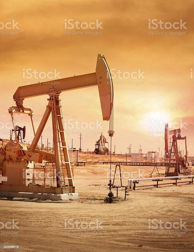 Pump jacks at oil field stock photo