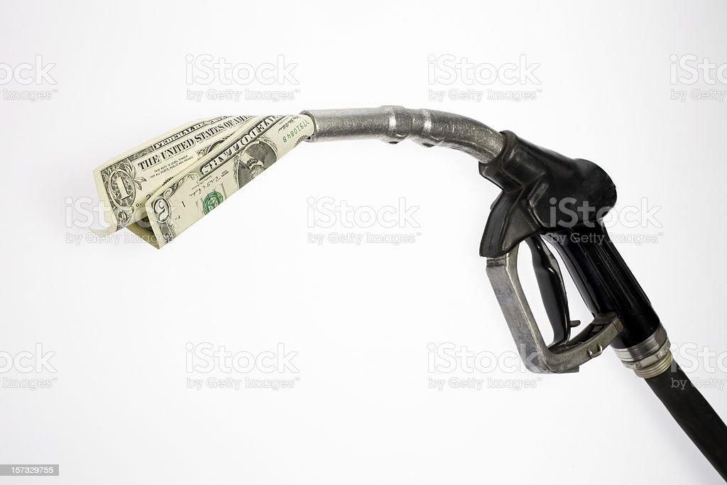 Pump nozzle sucking dollars stock photo