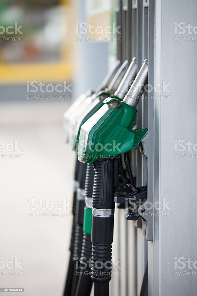 Pump nozzles at the gas station stock photo
