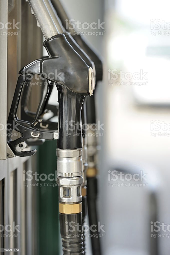 Pump nozzles at the gas station royalty-free stock photo