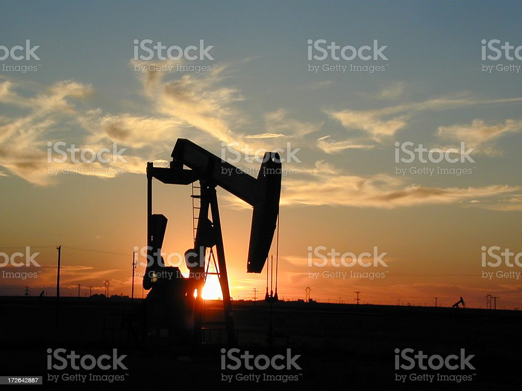 A pump outside during a beautiful Texas sunset stock photo