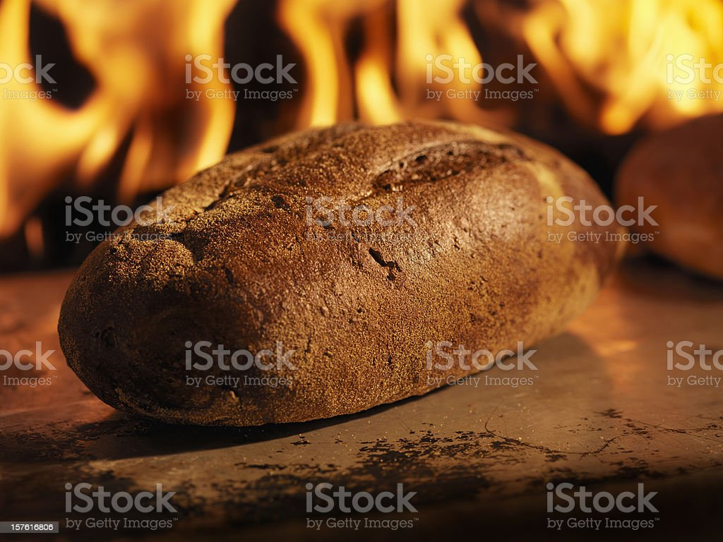 Pumpernickel Bread in a Wood Burning oven stock photo