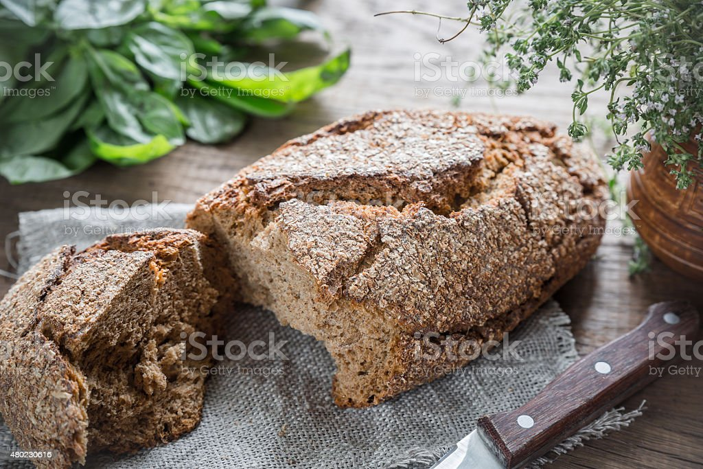 Pumpernickel on the wooden table stock photo
