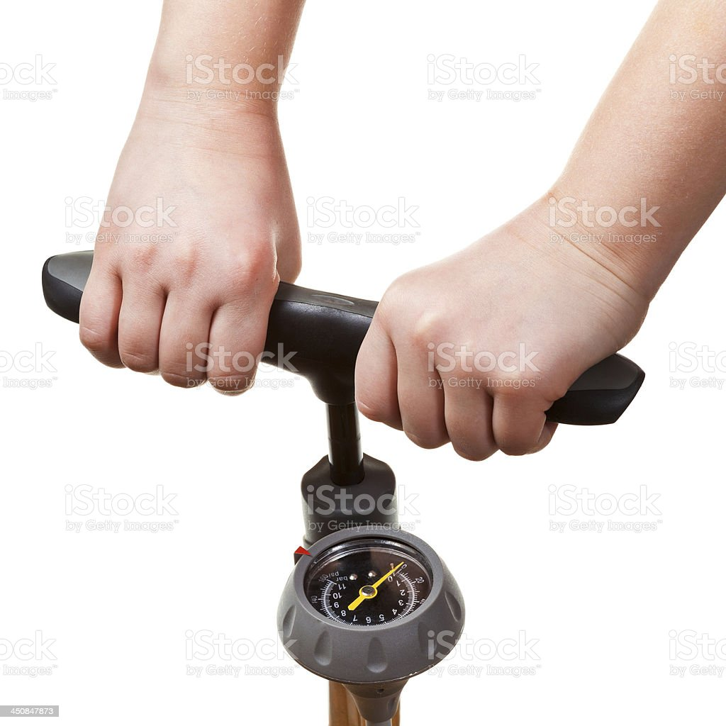 pumping by manual air pump with pressure indicator stock photo