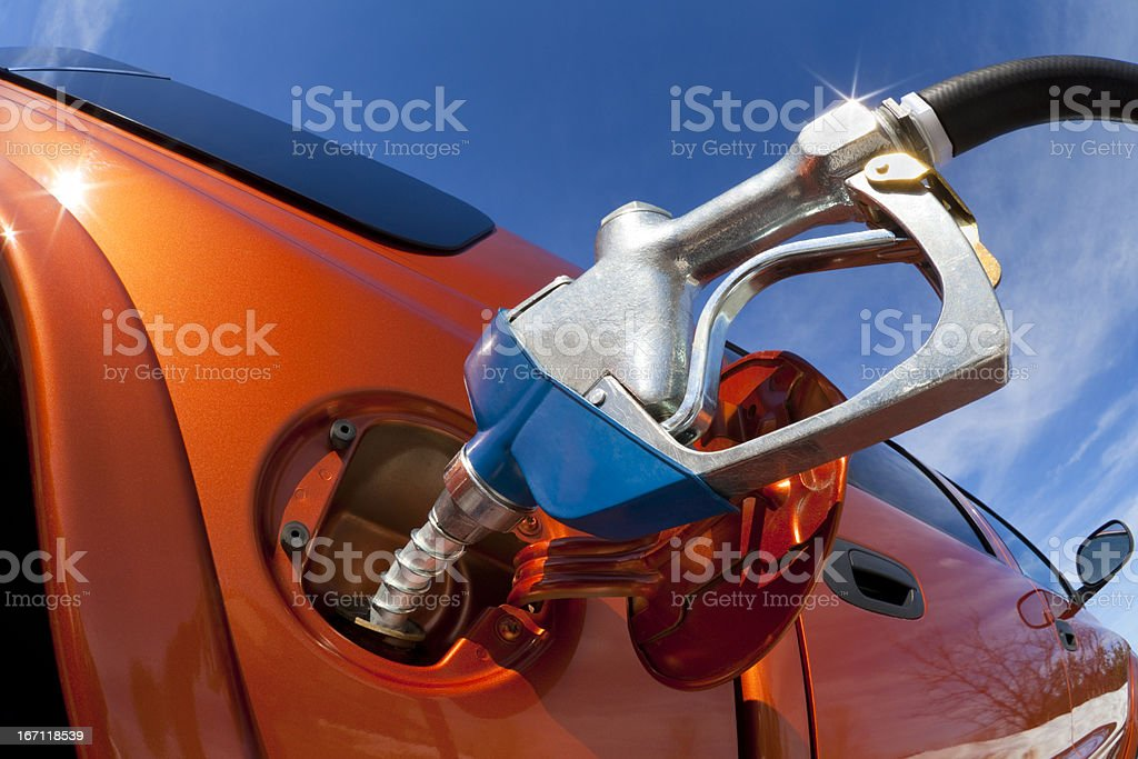 Pumping Fuel Into Gas-Guzzler Vehicle royalty-free stock photo