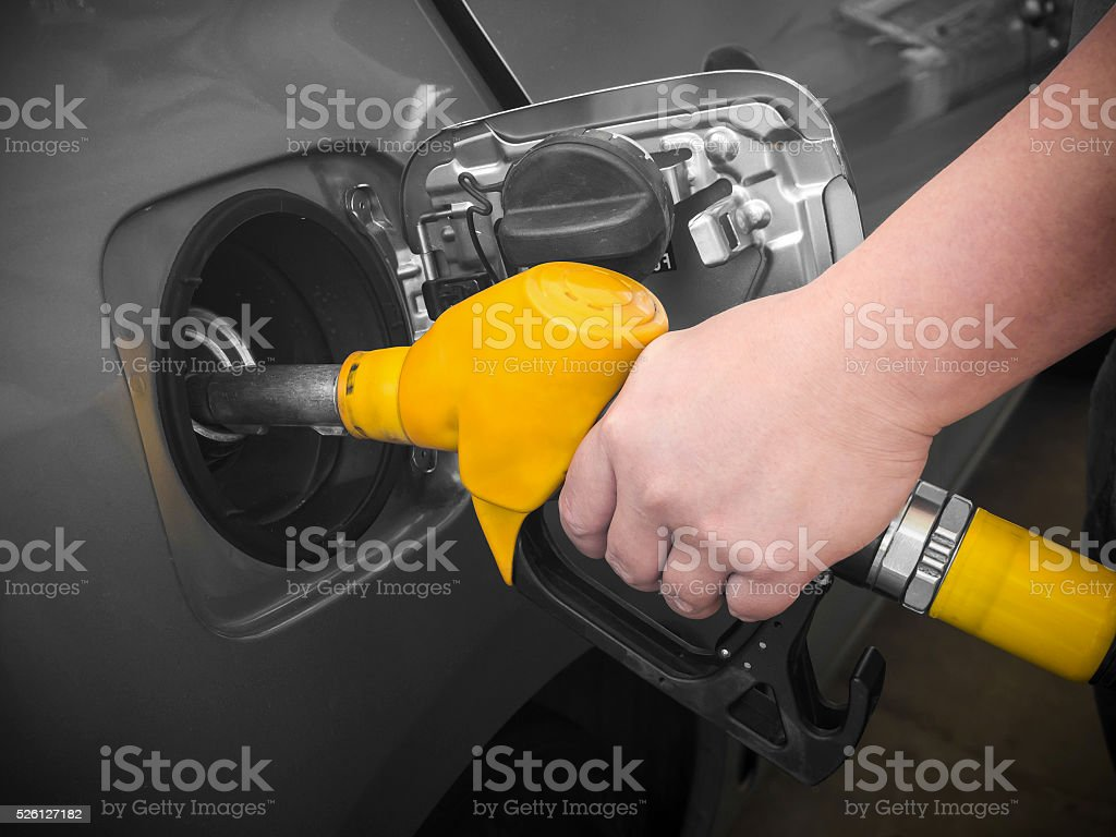 Pumping gas at gas pump. stock photo