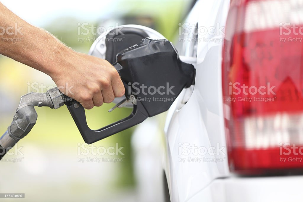Pumping gas at pump stock photo