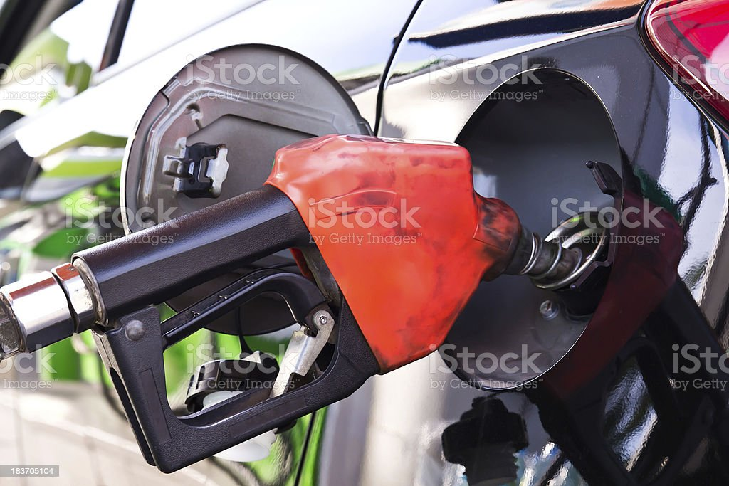 Pumping gas in to the tank royalty-free stock photo
