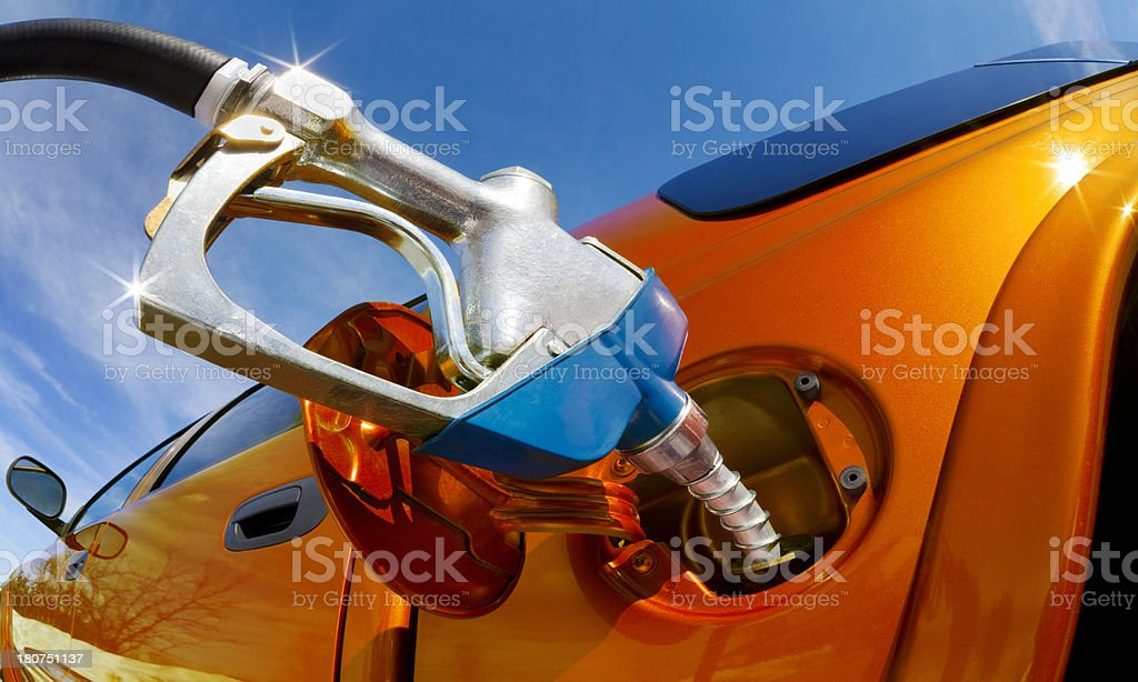 Pumping Gas Into Gas-Guzzler on Sunny Day royalty-free stock photo